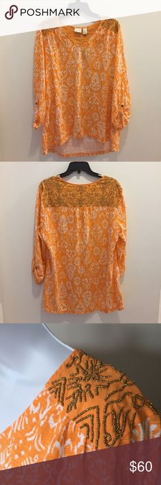 🆕 Chico's beaded top Chico's beaded top. Button cuffed sleeves. Orange and white with gold beading! NWT. Size 3 which is equivalent to an XL/16. Chico's Tops Blouses