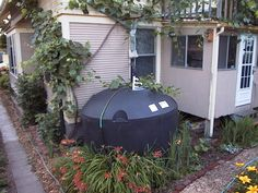 Rainwater Harvesting and Purification System - 1500 gallon cistern fed from 2 gable downspouts.