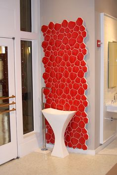 Hastings Chelsea Pedestal sink in front of a 'hot' red tile display