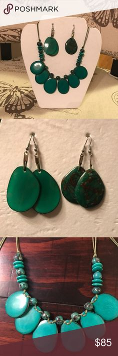 A gorgeous handmade Tagua jewelry set. This necklace and your choice of one set of earrings are made from Organic Tagua, which is the seed of the palm tree fruit, otherwise known as Vegan Ivory. It is hand picked, carved, colored, designed and place on a delicate yet natural looking green leather slip knot necklace. The color is waterproof and will not fade.Both sets of earrings are elegant yet one giving a more natural look. Jewelry