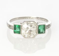 Platinum, diamond and emerald estate ring