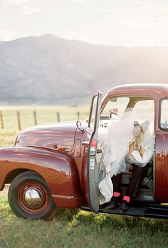 Brides.com: A Glamorous Wedding with Rustic Touches. The couple arrived at the party in the bride's dad's 1950s Chevy truck.