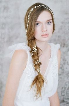 Twigs & Honey Extra Long Petite Blossom Hair Vine. Ornamented with a mix of sparkling crystals and softly luminous freshwater pearls, this ethereal headpiece is crafted from finely twisted brass that resembles a gently waning vine. The romantic design can be gracefully woven in and out of your locks whether they are upswept or free-flowing. $375