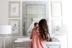 arielle charnas' nursery reveal. featuring our marcelle wide dresser & topper, 18th c. venetian cut-glass mirror, nathalie crystal floor lamp and pressed botanical art.