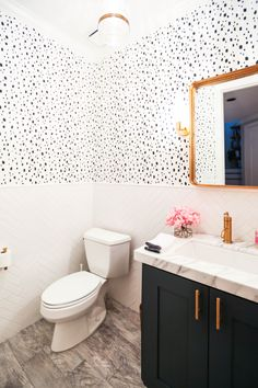 Navy Spotted bathroom in Caitlin Wilson Wallpaper. Click through for all the details!