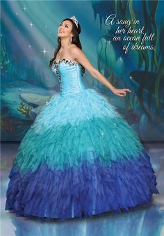 Cascading waves of glamorous ombre tulle and oceans of luxurious jewels pay tribute to Ariel's courageous yet free-spirited nature.