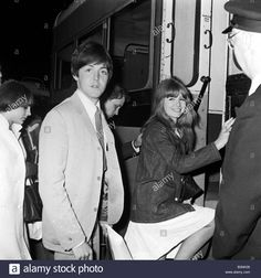 Download this stock image: Beatles singer Paul McCartney singer with girlfriend Jane Asher getting onto a bus June 1965 - B3NK06 from Alamy's library of millions of high resolution stock photos, illustrations and vectors.
