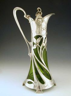 """Silver plate on pewter claret jug with a green glass liner and stunning full length art nouveau maiden decoration. From Germany circa The """"maiden"""" is on the other side of the jug, I don't particularly like that part but I like this side. Antique Glass, Antique Silver, Jugendstil Design, Art Sculpture, Art Nouveau Design, Art Nouveau Jewelry, Arts And Crafts Movement, Vases, Art Decor"""