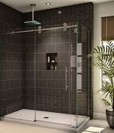 I was thinking about getting a new shower door, ours is really old. I think there are stains on there that are from the people who lived there before us. I love how these glass doors are almost transparent, I want something like this.