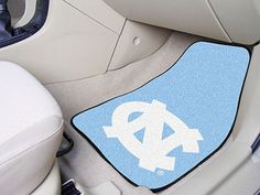 The North Carolina Tar Heels 2-pc Carpet Car Mats keep your cars or trucks front seat floors clean and are made in the USA by FanMats