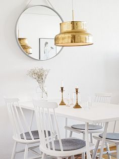 white and gold.. ( love that gorgeous light fixture)