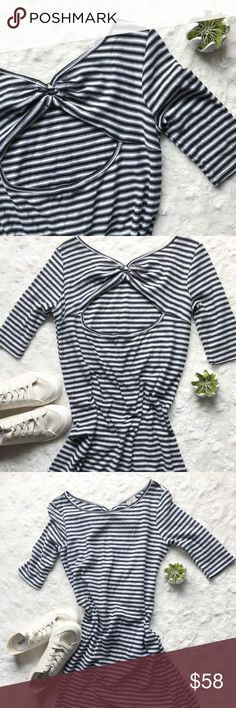 """{Free People} Frenchie Tee Dress NWOT The ultimate in effortless weekend chic. Pair it with sneakers or sandals for a cool, laid-back look. This relaxed black and white stripe dress features a wide neck and elbow sleeves for a classic look. The back gathers into a metal ring at the cutout back.  Brand: We The People Color: Black and White Stripe Condition: NWOT Fit & Size: XS Fabric Type: Cotton. Machine washable. Approx. Measurements: Sleeve 13"""", Length 34.5"""", Pit to pit 17""""  Bundle and…"""