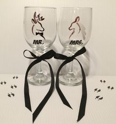 A personal favorite from my Etsy shop https://www.etsy.com/listing/271194758/camo-buck-doe-deer-wine-glasses-set-of