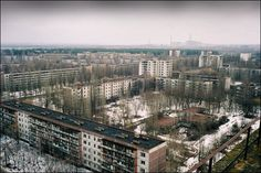 Abandoned Pripyat with the ghost of Chernobyl in the background.