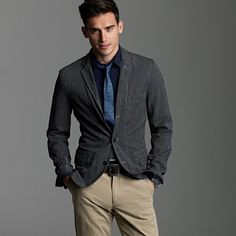 More casual coat and khakis. The slim fit makes the outfit awesome, anything else and it would be painful to look at.