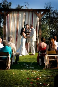 Wedding arch..just an example.  Maybe with burlap and lace fabric draped?