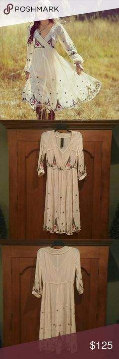 RARE Free People Embroidered White Midi Dress NWOT New Romantics by Free People off white embroidered midi dress. Crochet lace detail around v neckline and bust, embroidery all around hem, waist and sleeves in a black and a red pink color. Size L, but can also fit XL. 3/4 length sleeves. Love it, It's just too big. Midi tea length. Open to offers. Free People Dresses