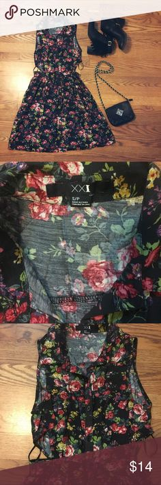 Floral print black dress 🌼🌸👗 Black floral print dress with cutouts on each side. It's in perfect condition. Has buttons in all the chest area and they stop at around the waist. Not super short, more like a mid thigh length.💥BUNDLE and SAVE💥choose any 3 items in my closet of under $25 and only pay $25🙌🏼. Let me know and I will put them all in a listing for you. Forever 21 Dresses