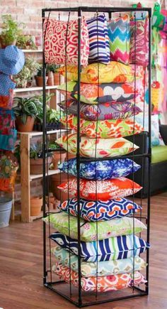 Great Pillow Display.....love that the cushions can be seen from all sides. Visual merchandising. Retail store display. Home accessories.