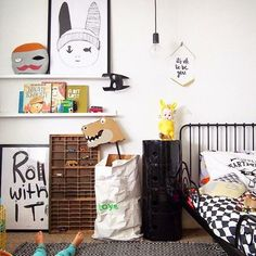 Cute kids room - love the graphic prints on the shelves! www.homeology.co.za