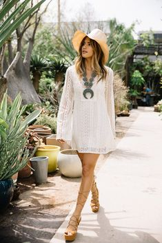 There is almost nothing more elegantly bohemian than a white lace dress! Rachel Barnes has created perhaps the ultimate sophisticated style here, pairing a little sheer white dress with knee high gladiator sandals and a classic wide brimmed hat for authenticity. Outfit: Guess.