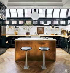 At the Manhattan apartment of designers Nate Berkus and Jeremiah Brent, the kitchen is outfitted with cabinetry and butcher-block countertops. Nate Berkus, Architectural Digest, Celebrity Kitchens, Celebrity Houses, New York City Apartment, Manhattan Apartment, Manhattan Kitchen, Manhattan Penthouse, Warehouse Apartment