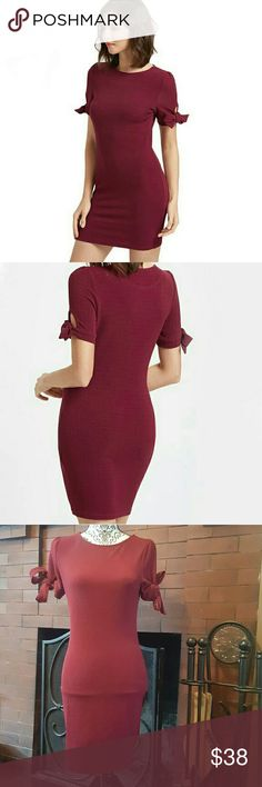 New! Maroon Dress Brand new without tags! Size small, true to its size. Material is super stretchy and form fitting. Ties into bows on the sleeves.  Offers welcome! Dresses Midi