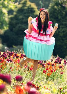 For the days when I just really feel the need to run dramatically through a field of flowers in a cupcake costume, holding cupcakes.