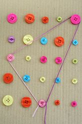 Buttons and yarn DIY geoboard