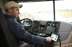 """J.J. Keller & A Encompass system (also pictured at top) can be paired with the company's specially designed tablet or with operators' personal Android or iOS devices. Tom Reader, J.J. Keller marketing director, believes the company is well-positioned. """"We're in virtually every truck stop in the country,"""" he says. """"We have operator market with paper logs. Right now, the electronic log at truck stops? We're not there yet."""" But it's coming soon. The engine connection retails at about $200."""