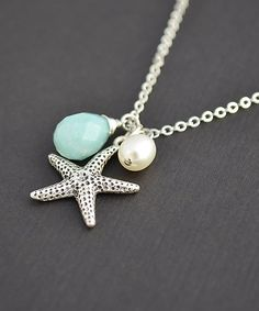 This reminds me of the necklace I gave my bridesmaids.  Love it!  Handmade Starfilsh Nautical Necklace