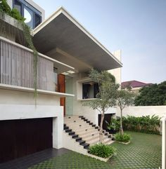 """Modern Family House- Static House, Jakarta, IndonesiaLocated in Jakarta, Indonesia, the Static House was designed by TWS & Partners. Here is the solution found by the architects: """" We tried to el. Modern Family House, Modern House Design, Custom Home Plans, Custom Homes, D House, Marquise, House Elevation, Exterior Design, Modern Architecture"""