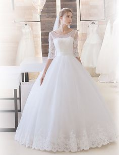 Illusion neckline lace tulle wedding dress. This gown is modest and stylish. A classic look that will still look amazing when you look back at your wedding photos years from now!