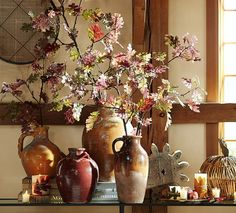 Master potters hand throw and glaze each terra-cotta vase in this eclectic collection. Different colors and accents, like rope handles and partial glazing, give each its own distinct character, yet all stand together as an imaginative set.