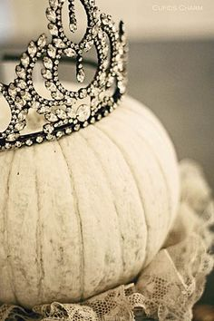 This is simple, but very charming! Just paint the pumpkin in a creamy white and top with a tiara - what a wonderful idea for a fall princess birthday!  ~segretosecrets.squarespace.com