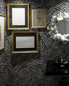The Powder Bath with Schumacher zebra wallpaper, high gloss Kohler black fixtures and a collection of antique pencil sketches found on eBay.