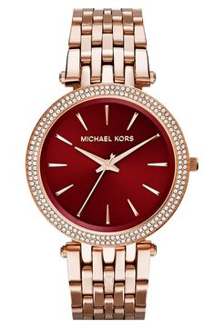 Crushing on this gorgeous rose gold and red Michael Kors watch.