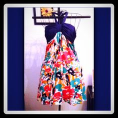 Cute lil floral dress Dress says size small fits up to a lg  Stretchy johnny martin Dresses