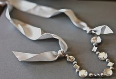 tie ribbon to ends of something sparkly for a pretty necklace - how easy is that?!