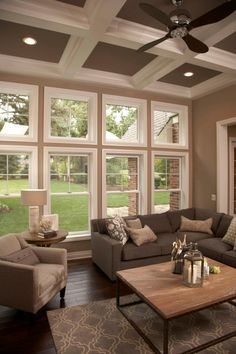 When Walking in, Instead of one Window facing backyard, Divide into sections....Square Top, Rectangle Bottom since we will be raising the floor of the Living Room to be leveled with rest of floor plan of home.  Maximum Light, nice wow factor when walking in...warm and inviting.