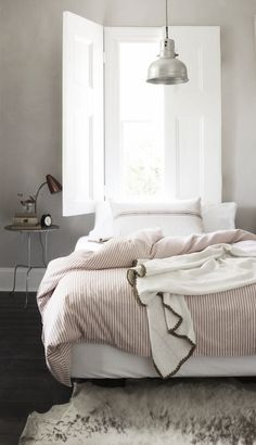 Pale Gray Walls / White Moulding / Dark Wood Floors / Pendant Light / Open Window / Side Table Decorations