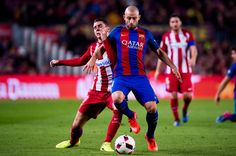 Javier Mascherano (R) of FC Barcelona fights for the ball with Lucas Hernandez (L) of Atletico de Madrid during the Copa del Rey semi-final second leg match between FC Barcelona and Atletico de Madrid at Camp Nou on February 7, 2017 in Barcelona, Catalonia.