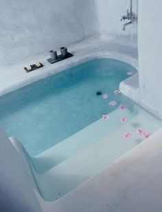 A bathtub that is sunk into the floor... it's like a pool in your bathroom!