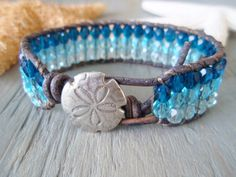 "Ombre sanddollar leather wrap bracelet, ""Beach Blues"", sky blue, ocean blue, distressed leather, beachy surfer boho chic, on SALE. $59.00, via Etsy."