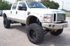 Lifted white Ford F-250 Super Duty Truck