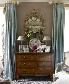 Gorgeous, glamorous, yet soft bedroom vignette by Miles Redd featuring matte milk chocolate walls, antique chest, antique mirror with scrolling gilt trim and topped with a tiny pagoda, icy blue silk taffeta drapes with ruffled trim, and that fabulous petite print leopard carpet. Perfect.