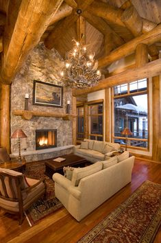 Chandelier + high ceilings + log beams = <3 Have always wanted a log cabin, with a wrap around porch.