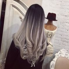 I love the deep contrast between the black and the grey.  Especially the cascade look.  It makes it appear as though dark water is tumbling into foam.  Her hair is also so healthy and I love that it goes from straight to wave....again, like a cascading waterfall.
