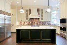 brick backsplash.  two-toned cabinets.