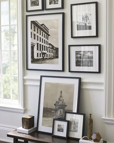 black and white framed pieces/photos for long entry hall wall- mix in one or two pops of color either in one or two frames, and/or within one of the framed pieces. Or, all black and white subjects with some random antique frames (brass, gold, silver, etc.)